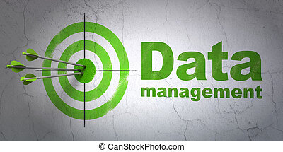 Information concept: target and Data Management on wall background