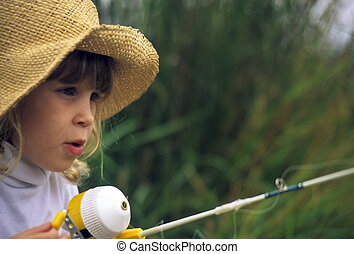Little girl fishing - Little girl in a straw hat with a...