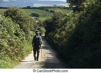 Man walking down a country lane in England
