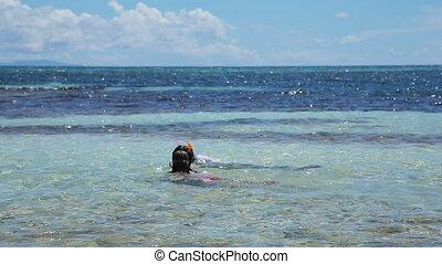 Happy kids swim in the sea