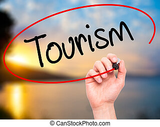 Man Hand writing Tourism with black marker on visual screen....