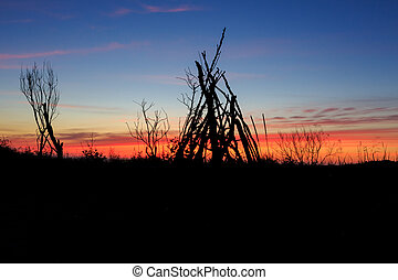 Stick Tipi at Sunset on Oregon Beach - Oregon beach with a...