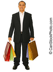 Happy Shopper - isolated shot of happy male shopper carrying...