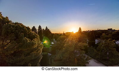 Beautiful sunset timelapse at Sabatini gardens near Royal palace in Madrid, Spain