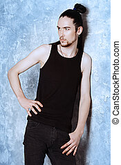 brunet man - A tall, thin man brunet posing by the grunge...