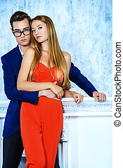 fashionable pair - Gorgeous couple of young people stand in...