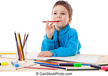 Inspired boy draw with crayons - Inspired little boy at the...