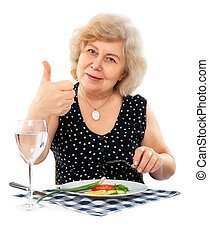 happy old woman eating healthy food isolated on white...