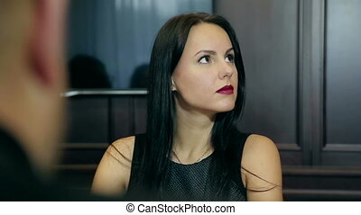 brunette woman listens attentively at a business meeting