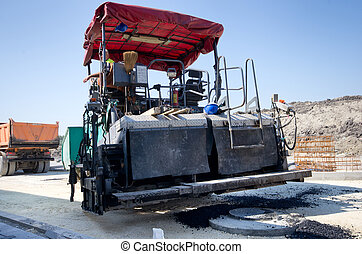 Asphalt finisher machine - Paving machine loaded with fresh...