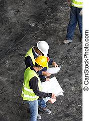 Engineers reading plan