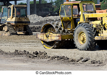 Roll compactor - Rusty roll compactor working on sand area...