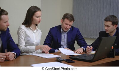 Two business people in elegant suits. Working in team together with documents sign up contract.
