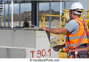 Construction worker with concrete beam - Construction worker...