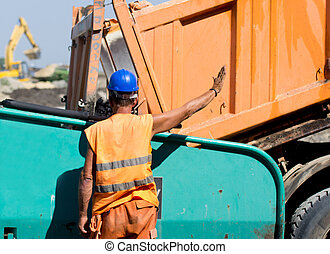 Worker on road construction site - Construction worker...