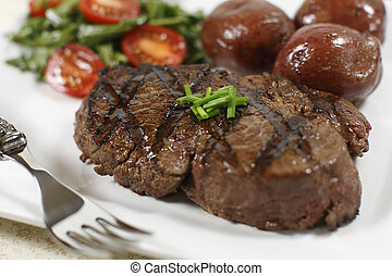 filet mignon cooked - cooked filet mignon steak in a white...
