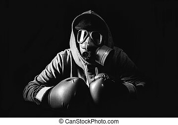 Angry man with mask - Angry man wearing gas mask and boxing...
