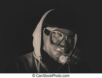 Man with gas mask - Man wearing mask and smoking,low key and...
