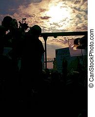 Sunset movie shooting - Camera crew shooting movie scene...