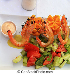 Grilled prawns and vegetable salad,square image - Grilled...