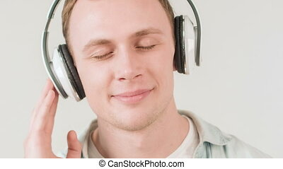 Young handsome man listening to music.