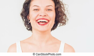 Young attractive woman is laughing merrily. - Happy laugh....