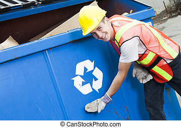 A worker who recycling thing on recycle center on the...