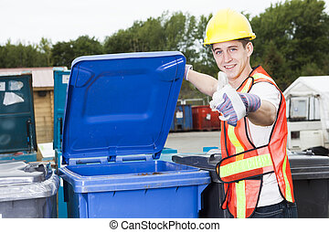 A worker who recycling thing on recycle center. A possitive...