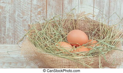 Chicken eggs in decorative straw nest. - Organic eggs. Few...