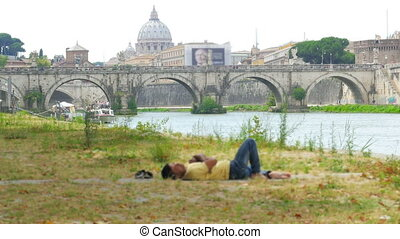 quot;immigrant sleeping on rome cityscape, refugee crisis,...