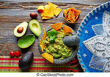 Guacamole with nachos in Mexican molcajete