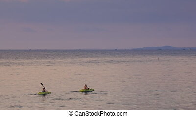 Two Men Paddle on Kayaks along Boundless Sea - two men...