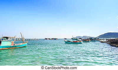 View of Fishing Boats Rocking in Bay against Sky