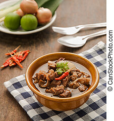 Thai beef curry in brown bowl