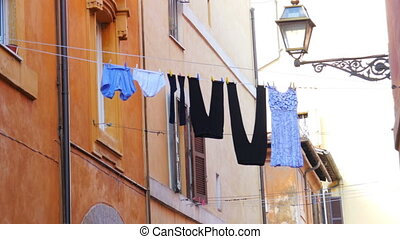 """traditional laundry, clothes linen on street, between..."
