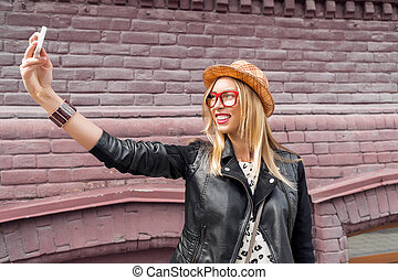 Girl visiting tourist attractions - Woman taking selfie with...
