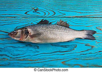 Seabass fresh fish on aqua wood