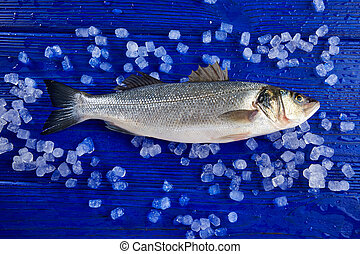 Seabass fresh fish on ice and wooden table