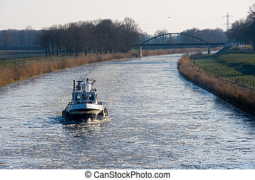 Icebreaker in Dutch canal breaks the ice in pieces