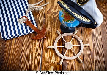 Decorative wooden steering wheel on an old wooden table