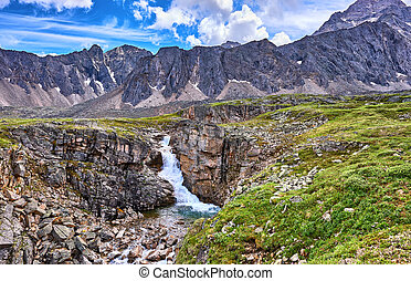 Waterfall in the canyon Mountain tundra of Eastern Siberia