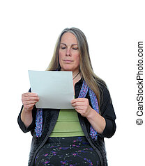 Woman reading paper - A middle aged woman reading a white...