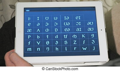Typing on a virtual keyboard of tablet pc. Closeup