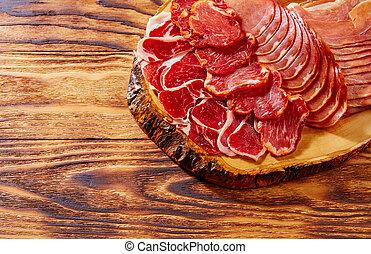 Tapas Iberico ham and lomo sausage Spain - Tapas Iberico ham...