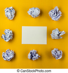 Crumpled paper balls and blank sheet of paper with pencil on yellow background. Paper wad. Creativity problems. Searching ideas.