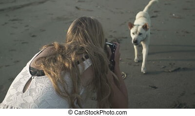 photographer in photo session with a dog - Smiling...