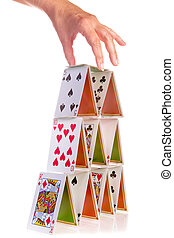 Hand and house of cards - Hand trying to add a fourth floor...
