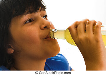 Soda pop - Boy drinking a soft drink out of a bottle