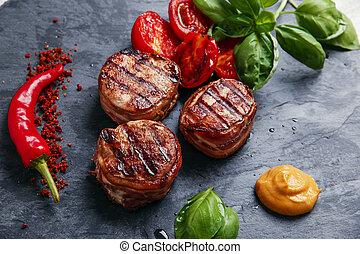Grilled meat fillet steak wrapped i