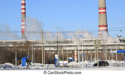 Thermal power plant in sunny cold day Industrial smoke from...